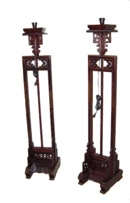 Pair of tall antique Chinese elmwood lamp stands.