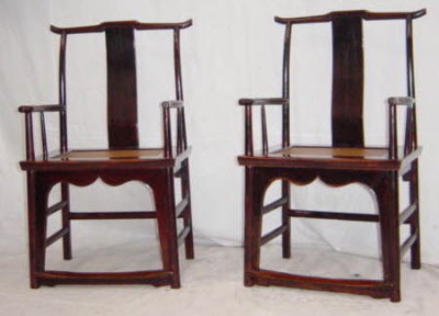 Pair of antique Chinese elmwood yoke back armchairs